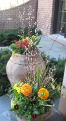 Spring Annual Container orange yellow flowers with pussy willow sticks
