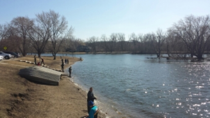 People fishing along the shore of mchenry dam